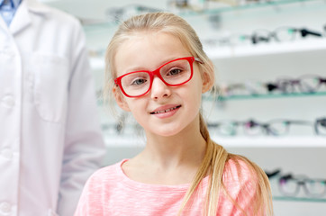 girl in glasses with optician at optics store