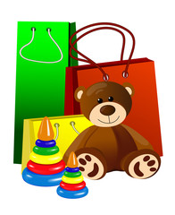 Teddy bear with toy pyramids on the background of gift bags
