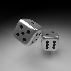 two silver dice over dark