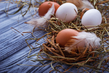 Brown and white eggs on  wooden background