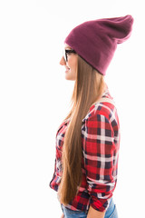 Side view photo of girl in glasses and violet cap