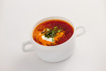 Fresh traditional Ukraine borsh with sour cream in bowl isolated