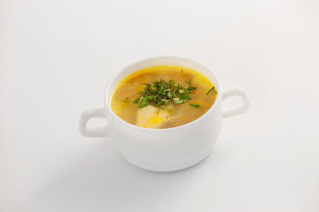 Closeup image of bowl with fresh chicken soup isolated
