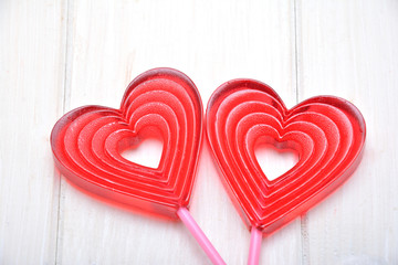Lollipops in the shape of the heart on the white background