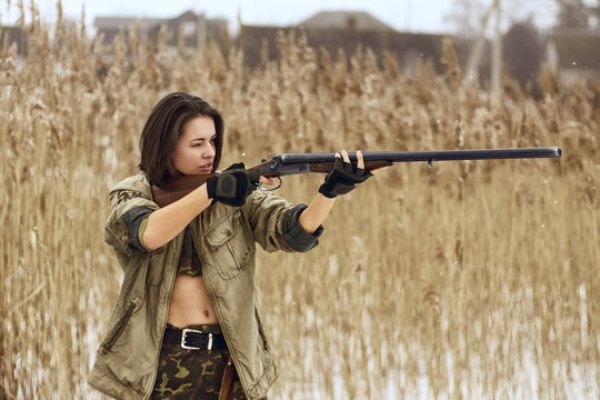 pretty girl with hunting rifle
