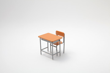 Miniature learning desk on white background