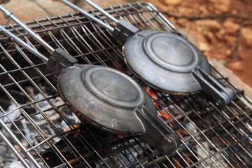 Camp food. Cooking jaffles.