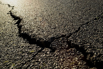 Detail of a big crack in an asphalt