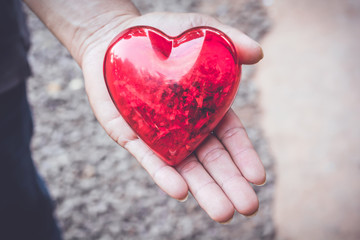 Male's hands holding red heart