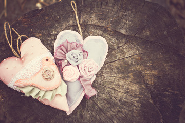Hand-made hearts  on the old board