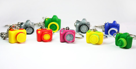 Multicolored figures cameras on the table
