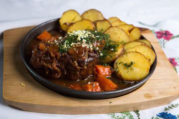 meat with baked potatoes