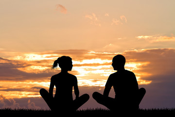 yoga couple silhouette at sunset