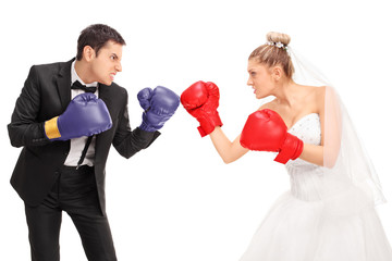 Bride and groom fighting each other