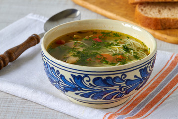 Homemade chicken soup on a table