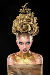 Magic golden girl with bright  glitter makeup and flower crown