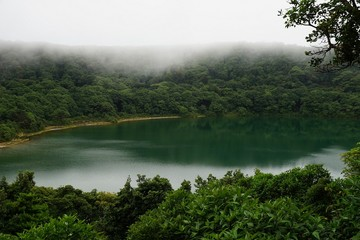 Beautiful lake in the crater of a volcano surrounded with tropical cloud forest, Costa Rica.
