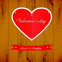 Darker wooden background, hearts and ribbon