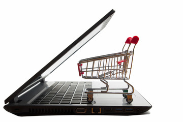 Online shopping concept - Empty Shopping Cart, laptop and tablet pc, smartphone isolated on white background. Copy space for text.