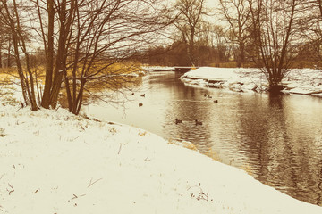 Winter landscape with river old-style retro
