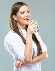 Water drink. Smiling woman with water glass.