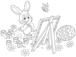Black and white vector illustration of a happy little rabbit drawing a decorated Easter egg on his canvas