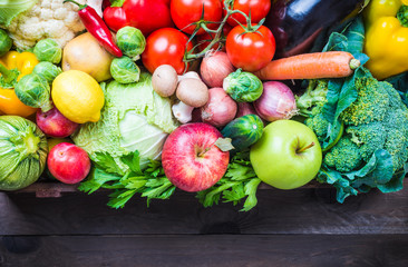 Vegetables and fruits in box, text space.
