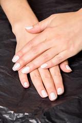 Close up of hands with nail polish
