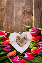 Bouquet of tulips flowers with heart for love.