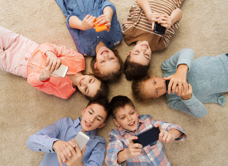 happy smiling children lying on floor in circle