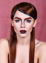 girl with an unusual make-up. Bushy eyebrows. Makeup for Halloween