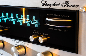 Macro shot of the gyro tuner of a classic stereo receiver from the 1970's.