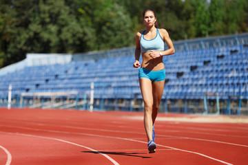 Runner - woman training.Female fitness concept