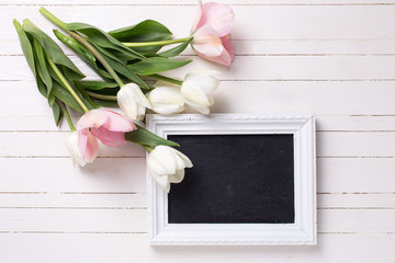Postcard with fresh white and pink flowers and empty blackboard