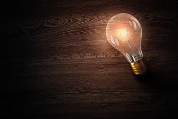 Light bulb on wooden surface