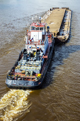 barge loaded with sand on the river