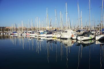 Barcelona, Spain - December 27, 2015: Port Olimpic marina in the city of Barcelona, Catalonia, Spain