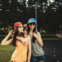 Portrait of two young girls girlfriends, lifestyle