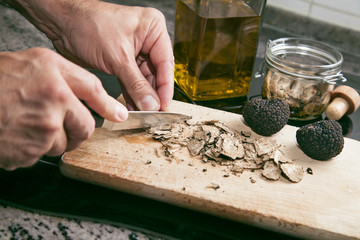 Cutting black truffles