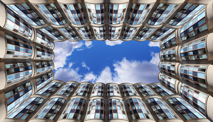 view up to the sky surrounded by modern skyscrapers