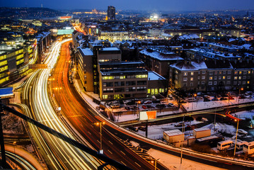 Night expressway in the city. Prague main road from birds perspective on long time exposure.