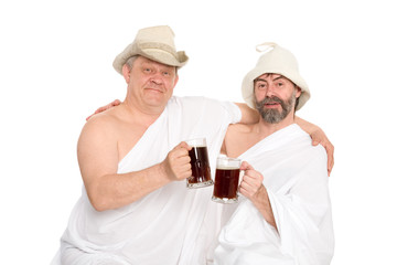Men in traditional bathing costumes drink kvas - Bread drink. From a series of Russian bath.
