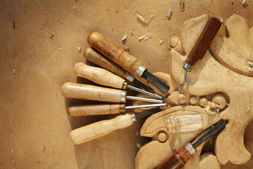 carving tool closeup on wooden background