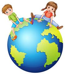 Boy and girl sitting on the big world