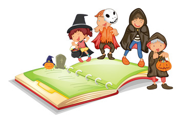 Children in halloween costume and a book