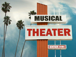 aged and worn musical theater sign with palm trees