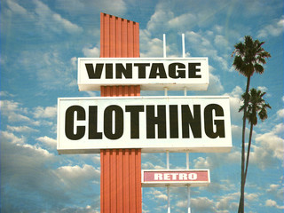 aged and worn vintage clothing sign with palm trees