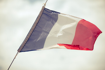 Full flag of France blue sky background