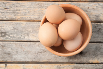 raw eggs in an earthenware bowl