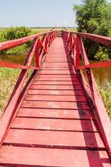 Red wooden bridge at Fort Nieuw Amsterdam in Suriname